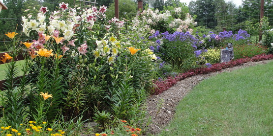 Mixed perennial border at LaDue Garden, a site on the 2015 Open Days Garden Tour