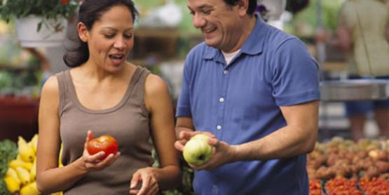 Buy Local Couple choosing fresh produce