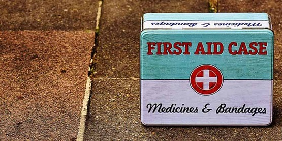 First aid kit on pavement