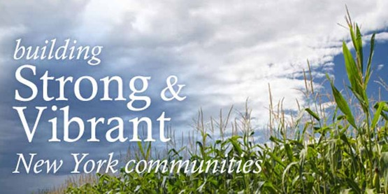 """Photo of cornfield with """"Building Strong & Vibrant Communities"""" in type"""