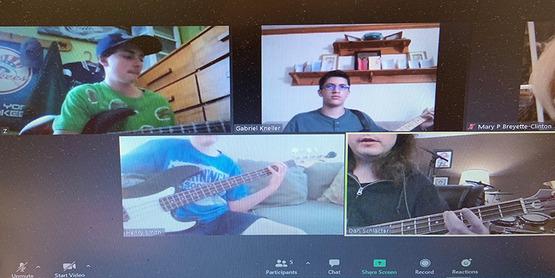 Bluegrass members playing guitars via Zoom