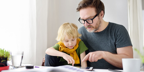 father home-schooling child