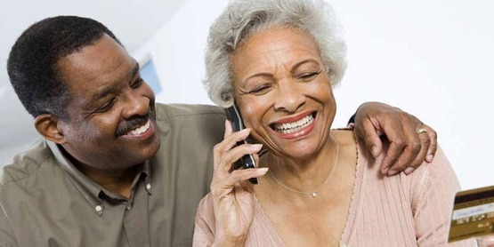 Senior African-American couple making a purchase using a credit card