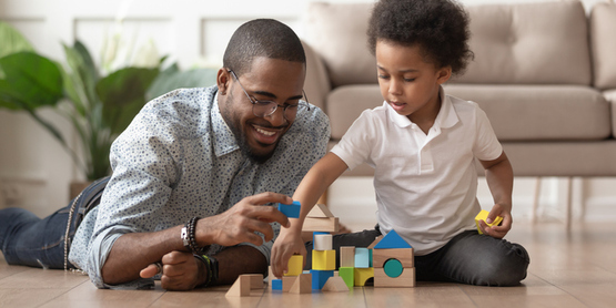 Father and son with building blocks
