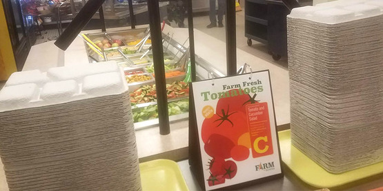 Sign at school salad bar promotes tomatoes
