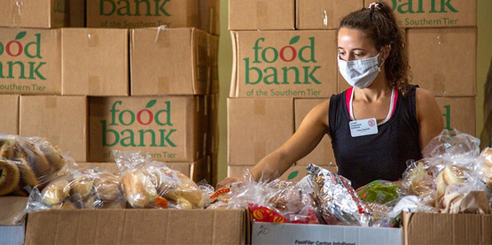 Chloe Boutelle sorting pantry boxes from Food Bank of the Southern Tier