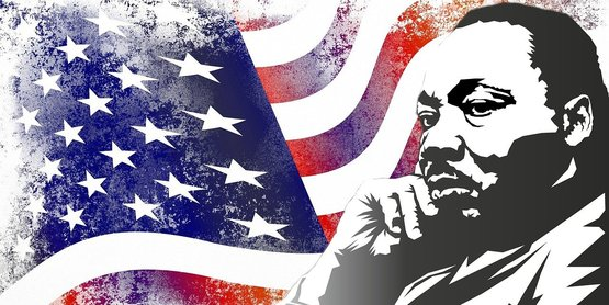 Stencil of Martin Luthor King Dr with an american flag backdrop