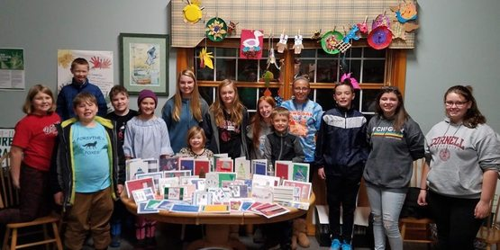 4-H members made holiday cards to send to the troops!