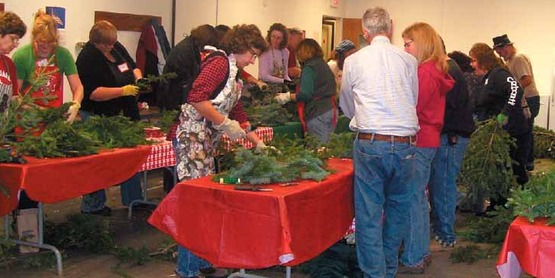 Wreath workshop participants are instructed by Mike Montario in making their wreaths, 2012.