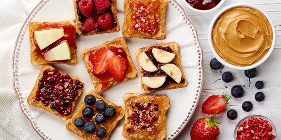 Peanut butter toast with various fruits