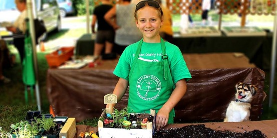 Tompkins 4-H member Alina Loginov with plant science project at 2019 4-H Youth 'Fair