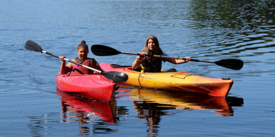 Two girls kayaking on Millsite Lake