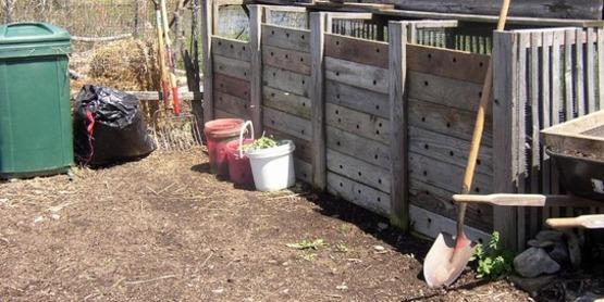 Three bay wooden compost bins.