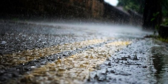 Heavy rain on falling onto a street.