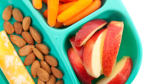 Snack plate with apples, cheese, and almonds