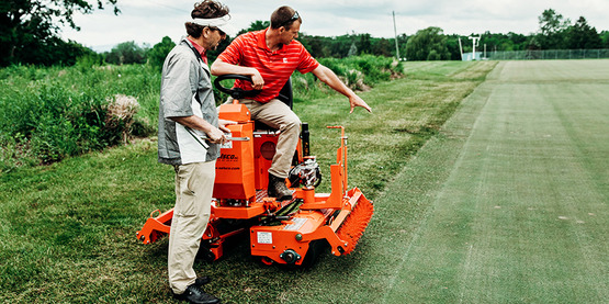 Dr. Rossi and student discuss turfgrass quality in a research trial