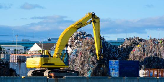 excavator in landfill