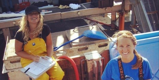 Fisheries Specialists Tara McClintock and Kristin Gerbino collecting data on a commercial fishing vessel