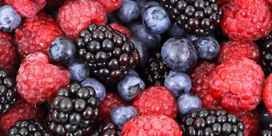 a picture of blueberries, raspberries and blackberries