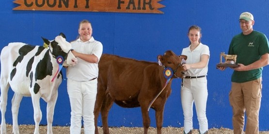 2021 4-H Dairy Showmanship Contest Winners: Left to Right- Ava Meyer, Country Critters 4-H Club received Reserve Grand Champion Showman; Erma Wolcott, Lone Member, received Grand Champion Showman; with Dan Crowell, 4-H Dairy Committee Chairman congratulating the youth.