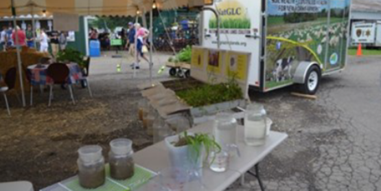 """This on-farm Soil Health Field Day will include interactive activities using the """"Soil Health"""" trailer equipped to measure and demonstrate the three vital components of soil health – Physical, Chemical, and Biological. Field soil pits will also provide much to see and learn about soils."""