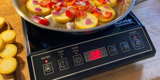food cooking on portable induction cooktop