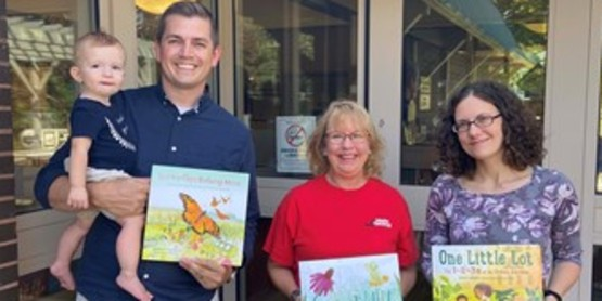 The three books being presented to Library by Pat Bowroski-CCE Master Gardener(middle), Bob Lingle-Off the Beaten Path and son Henrik, and Shannon Taylor, Director Lakewood Memorial Library