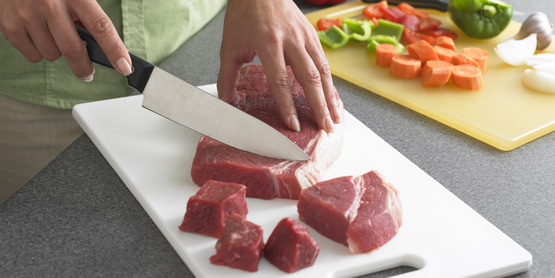 After cutting raw meats, wash cutting board, utensils, and countertops with hot, soapy water.