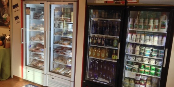 Frozen meats, dairy, and locally made beverages in the Market's freezer and cooler