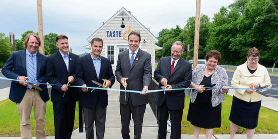 Ribbon-cutting ceremony to mark the opening of the Taste NY Market at Todd Hill
