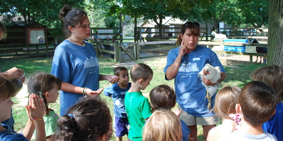 Suffolk County Farm educators teaching children about animals