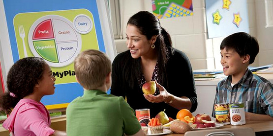 A nutrition educator teaches children about MyPlate.