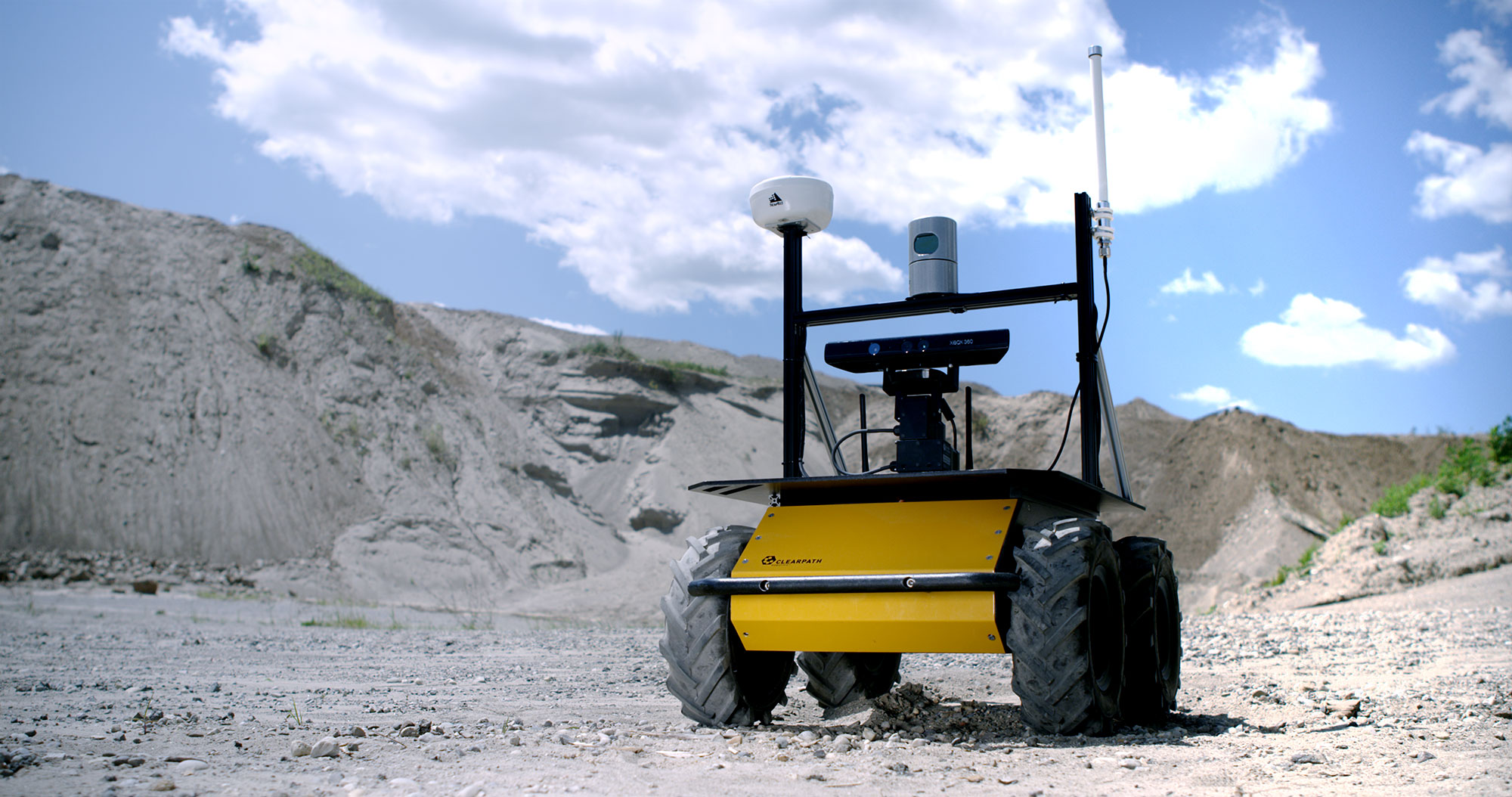 Black Yellow Husky Robot GPS Lidar Gravel Pit