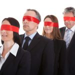 blindfolded businesspeople