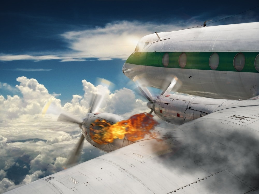 plane in flight with engine on fire