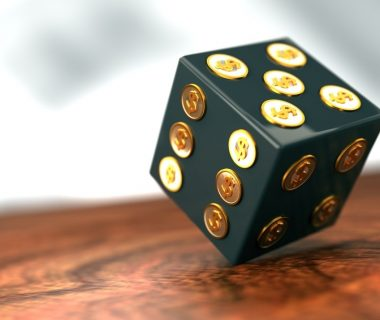 black die with gold dollar sign dots