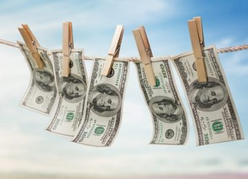 hundred dollar bills drying on a clothesline