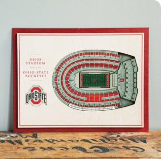 A 3D stadium replica is displayed as wall art.
