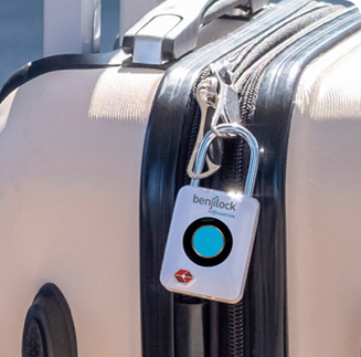 A suitcase is secured with a fingerprint lock.