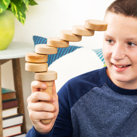 A child tries to get these rotating magnetic beech wood discs to line up just right.