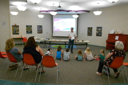 Children listen to Jeff Tish discuss birds.
