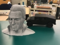 Picture of The Terminator and a car printed with the Decatur Public Library's 3D printer