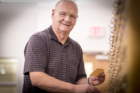 A Patron Holding A Catalog Card From Local History