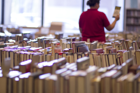 A customer browses the selection at the Friends of the Library Book Sale