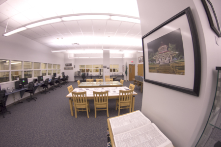 A photo of the tables and microfilm stations in the Local History room