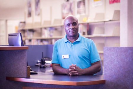 Circulation Manager Robert Edwards stands ready to help at the Circulation Counter