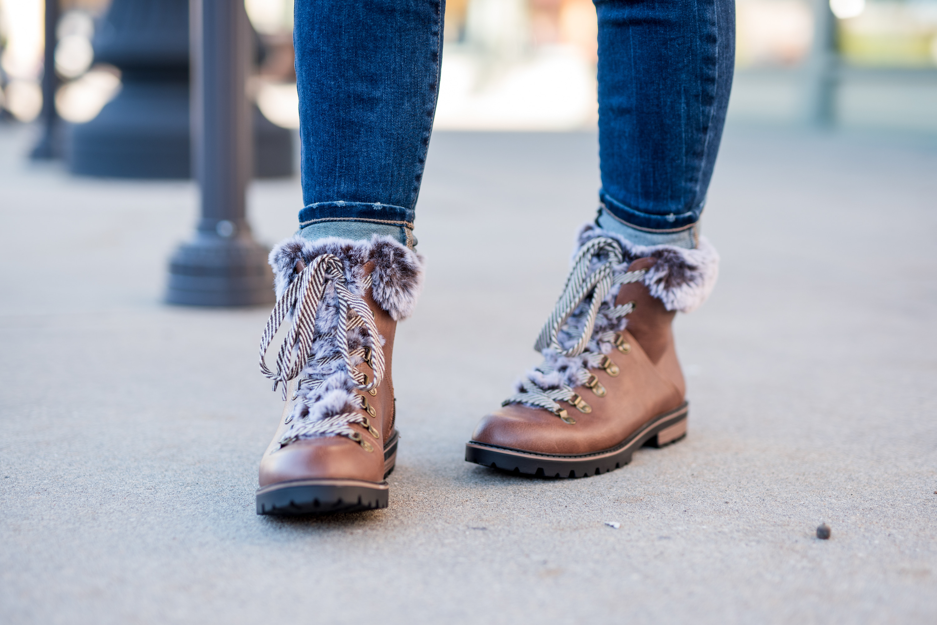 Maurice's Clothing by popular Houston fashion blog, Fancy Ashley: image of a woman wearing jeans and brown fur trimmed combat boots.