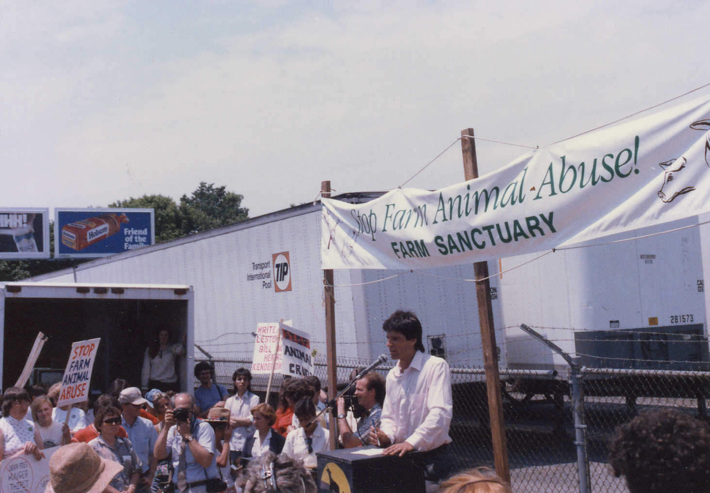 Gene Baur speaks at a protest at the Lancaster Stockyards