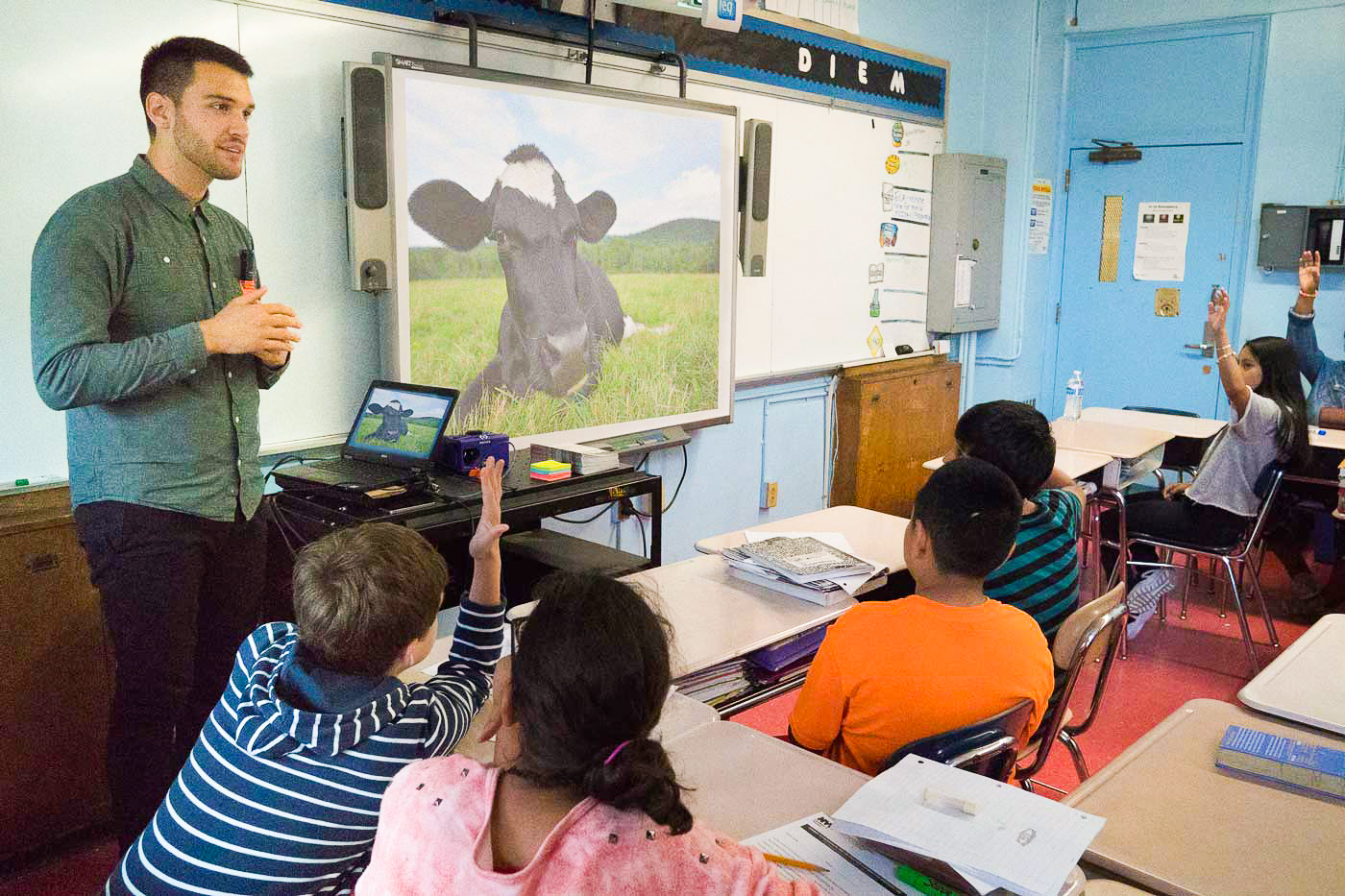 Vertical explainer photo 1 - Humane educator gives a presentation in the classroom