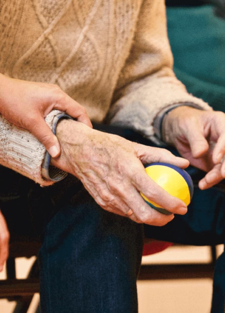 Elderly man's pulse being taken.